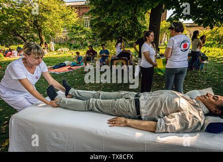 Italy Piedmont Turin Valentino Botanical garden - Wellness activity at the botanical garden -  shiatsu massages - Stock Image
