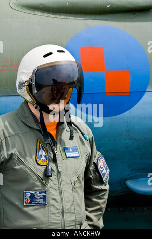 Croatian Air Force MiG-21 BISD fighter pilot beside national insignia on fuselage - Stock Image