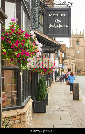 Shakespeare Hotel in Stratford upon Avon with colourful hanging baskets - Stock Image