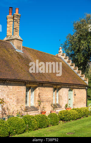 Gatehouse attached to the North gate of Holkham Hall, North Norfolk, East Anglia, England, UK. - Stock Image