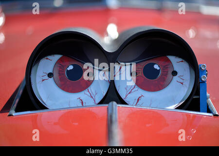 Westbury, New York, USA. June 12, 2016. Funny red eyeballs decorate Scoop Flaps of carb Shot Gun style Hood Scoop - Stock Image