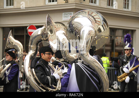London, UK. 1st January, 2019. About 8,000 performers representing the London boroughs and over 20 countries from across the globe take part on the annual New Years Parade on the street of London. The parade run from Green Park Tube station to Parliament Square. Photo credit:  David Mbiyu/Alamy New Live - Stock Image