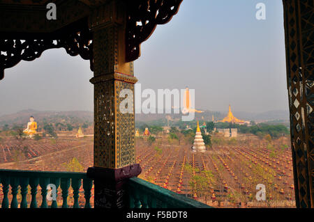 Tower in the The Ten Thousand Buddha Garden overlooking the second tallest Buddha statue in the world at Bodhi Tataung,Myanmar - Stock Image