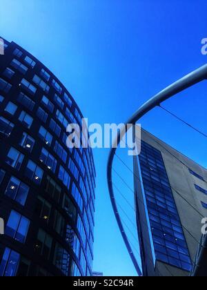 Modern and contemporary skyscrapers or high rise buildings with angular lines and soft curves - Stock Image