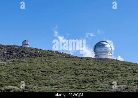 Telescope observatories on the landscape at Roque de los Muchachos, La Palma, Canary Islands, Spain - Stock Image
