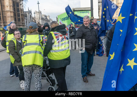 London, UK. 9th January 2019. Protests by stop Brexit group SODEM (Stand of Defiance European Movement) and pro-Brexit campaigners continue opposite Parliament. Among the pro-Brexit campaigners were again some extreme-right 'yellow jackets', most of whom were fairly subdued.  Police still seemed reluctant to act against possible breaches of public order when SODEM protesters were harassed,. Credit: Peter Marshall/Alamy Live News - Stock Image