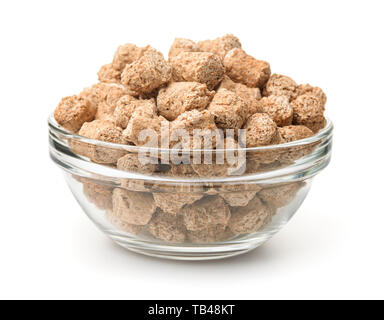 Glass bowl of extruded oats bran pellets isolated on white - Stock Image