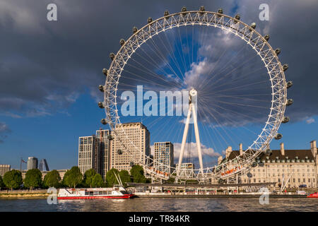 The London Eye, Marriott County Hall and Shell HQ from Westminster Pier Victoria embankment with City Cruises tour boat Westminster London England UK - Stock Image
