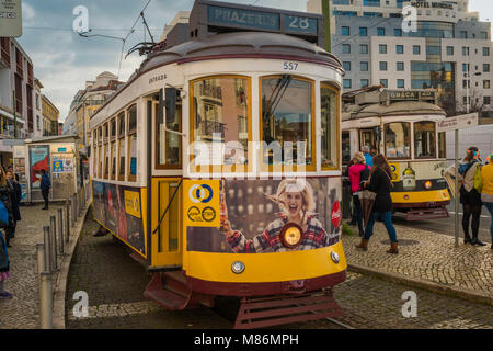 LISBON / PORTUGAL - FEBRUARY 17 2018: FAMOUS OLD YELLOW TRAM IN THE CITY OF LISBON - Stock Image