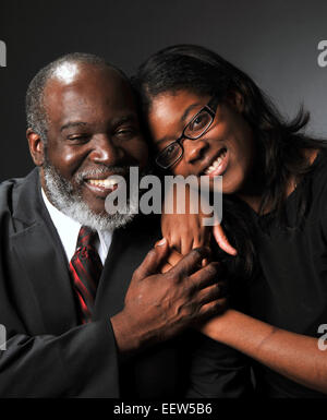 Father's Day portraits. Reverend Jose Jean Champagne, with his daughter Melissa Vera, age-22. (New Haven CT - Stock Image