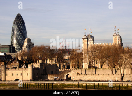 Swiss Re Tower and The Tower of  London - Stock Image