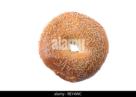 Homemade fresh bagel with sesame seeds and sea salt. Isolated on white background. - Stock Image