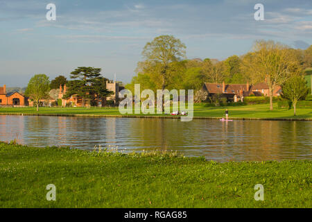 A Summer picnic by the River Thames in the evening sun by the village of Remenham, Berkshire, - Stock Image