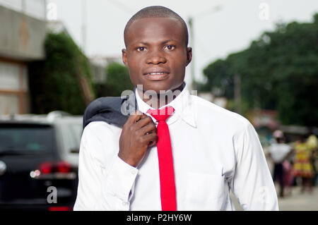 Portrait of young African businessman leaving in the morning for work. - Stock Image