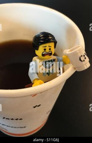 LEGO minifigure screaming for coffee - Stock Image