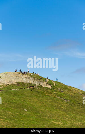 Walkers enjoy the experience of reaching the summit of  Cat Bells (451 metres) near Keswick, Cumbria. - Stock Image