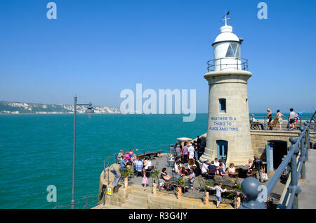 Folkestone Harbour, Kent, UK. People enjoying refreshment at the Lighthouse Champagne bar the on the popular Harbour Arm. - Stock Image