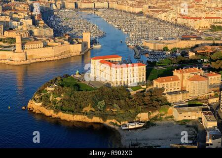 France, Bouches du Rhone, Marseille, 7th arrondissement, Pharo Cove, the Palais du Pharo, the Old Port and the Fort Saint Jean listed as a Historic Monument in the background (aerial view) - Stock Image