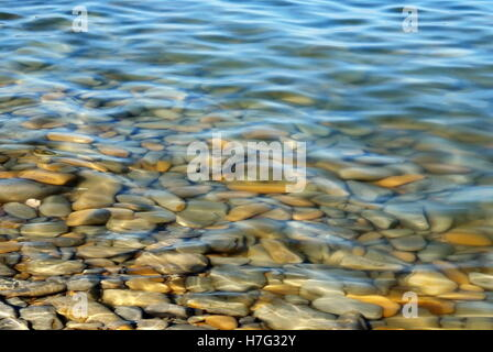 stones under the water sea in summer - Stock Image