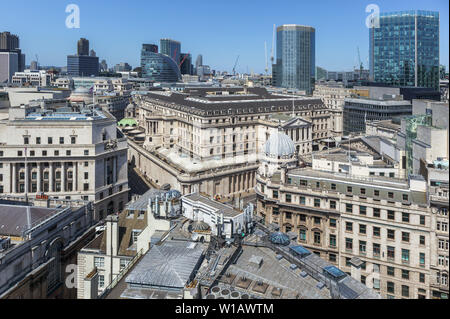 Rooftop view of the Bank of England headquarters building in Threadneedle Street surrounded by old and modern buildings in the City of London financial district, EC2 - Stock Image