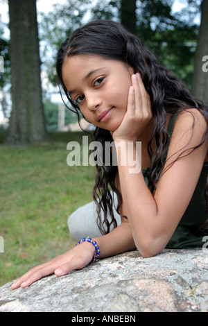 Portrait of a hispanic girl looking at the camera - Stock Image
