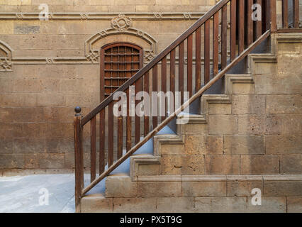 Staircase with wooden balustrade leading to Zeinab Khatoun historic house, Darb Al-Ahmar district, Old Cairo, Egypt - Stock Image