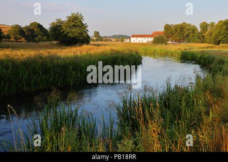 Haraldskær Manor at Vejle Å (Vejle River) in southern Jutland, Denmark - Stock Image