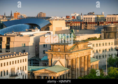 brandenburg gate quadriga view from Reichtstag dome background new american embassy Tiergarten Berlin - Stock Image