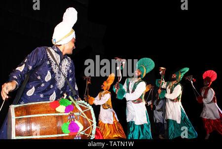 Traditional  Punjabi dance on Stage - Performance - Stock Image