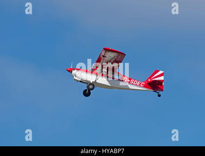 An American Champion light single engine private aircraft Leaving Inverness Dalcross airfield, Scotland. - Stock Image