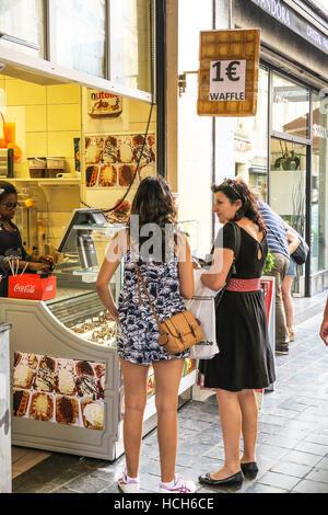 Buying Waffles in Brussels, Belgium. - Stock Image