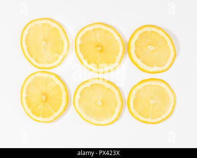 sliced lemon on a white background - Stock Image