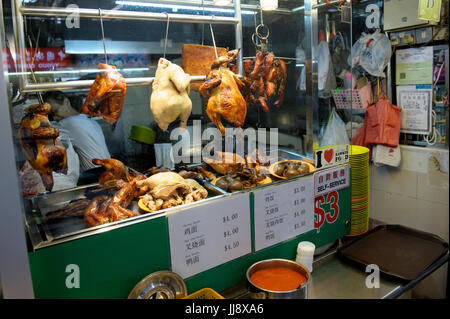 Selection of cooked meats for sale in hawker's stall, Chinatown, Singapore - Stock Image