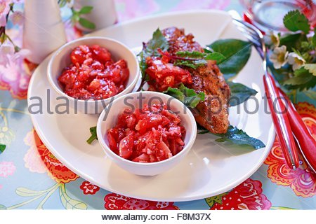 Strawberry salsa to serve with grilled meat - Stock Image