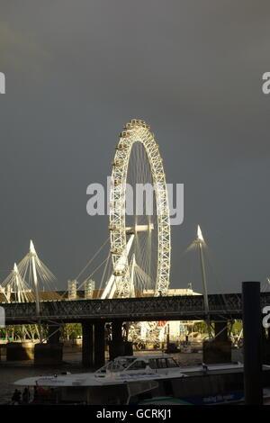 Storm Clouds, London Eye, London UK - Stock Image