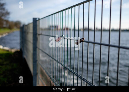 Padlocks On Railing By Sea - Stock Image