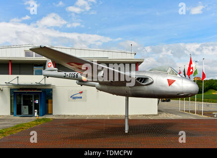 Jet fighter De Havilland Vampire FB.6 of the Swiss Air Force at the entrance to the Clin d'Ailes Museum of Military Aviation, Musee de l'Aviation Mili - Stock Image