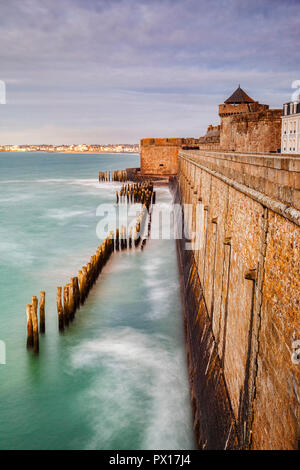The ramparts and sea defences of Saint-Malo, Brittany, France, at high tide. Long Exposure. - Stock Image