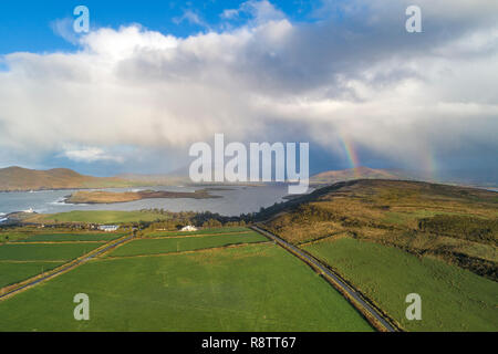 Dramatic clouds and double rainbow, over Valentia Island County Kerry, Ireland - Stock Image
