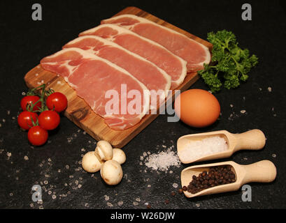 Bacon ready to cook breakfast. - Stock Image