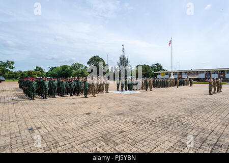 Soldiers stand at ease during the closing ceremony of Hanuman Guardian 2018 after 10 days of training between the U.S. Army and the Royal Thai Army Aug 30 at the Royal Thai Army's Cavalry Center in Thailand's Saraburi province. Hanuman Guardian is a bilateral army-to-army exercise that strengthens capability and builds interoperability between U.S. and Royal Thai Army forces. - Stock Image