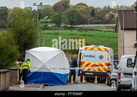 Macroom, West Cork, Ireland. 8th Oct, 2018. A Garda tent covers the body of a 44 year old murdered man. The man, from Clonakilty, was pronounced dead shortly after 2am this morning. The State Patholigist is due on the scene at 4pm today. Credit: Andy Gibson/Alamy Live News. - Stock Image