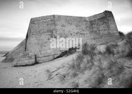 Bunker left over from WW2 on a Normandy beach - Stock Image