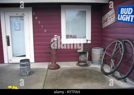 A bar in Yolo County, CA draws people in with a skull in the front patio. - Stock Image