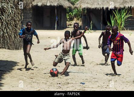 Boys playing football on Yele Island, the Turtle Islands, Sierra Leone. - Stock Image