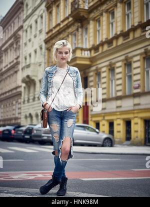 Street portrait of young woman in Prague, Czech Republic - Stock Image