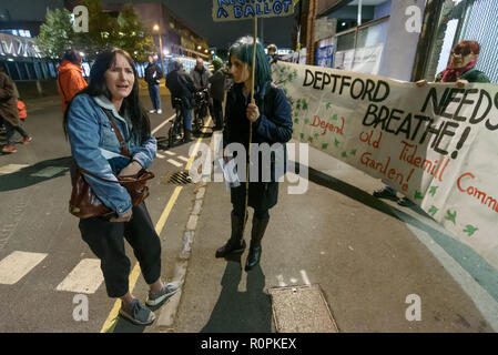 London, UK. 6th November 2018. Campaigners trying to stop Lewisham Council and developer Peabody from demolishing Reginald House and building on the community Old Tidemill Wildlife Garden  protest outside the New Cross Assembly Meeting where Lewisham Mayor and local councillors were expected to take questions from the public. Some protesters went inside the meeting while others continued the protest outside.  Locals who had occupied the wildlife garden were brutally evicted by bailiffs and police last week. Credit: Peter Marshall/Alamy Live News - Stock Image