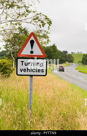 Turning vehicles warning road sign near a caravan and camping site on the A6 road near Kendal. - Stock Image