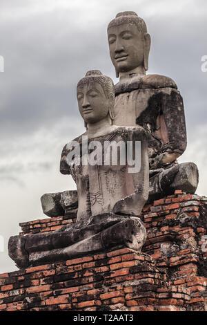Two Buddhas at Wat Chaiwatthanaram in Ayutthaya, Thailand. - Stock Image
