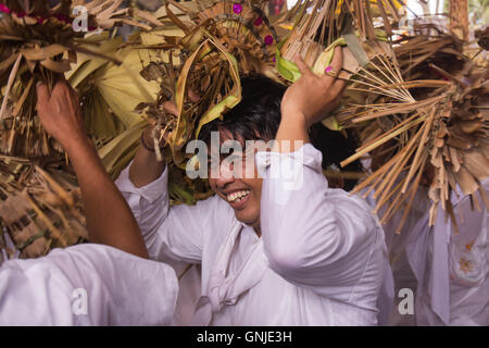 A  man just Smailing while doing the Ritual - Stock Image